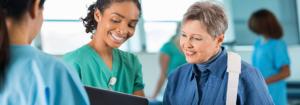 Image of nurse educating female patient